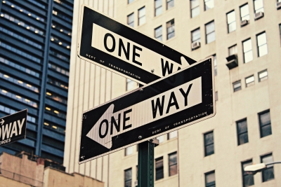 two signs reading one way